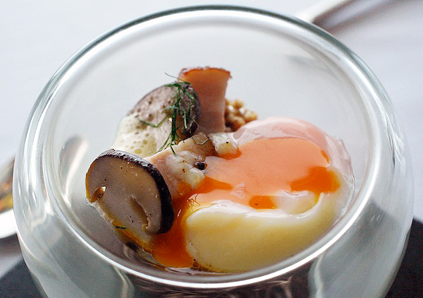 JAAN's 55-minute smoked eggs, oozed over a bowl of kurobuta, pickled cep, and toasted buckwheat