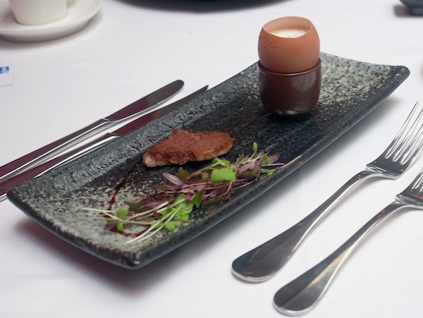 Confit egg with truffle essence, Iberico and PX reduction at Nicolas Le Restaurant