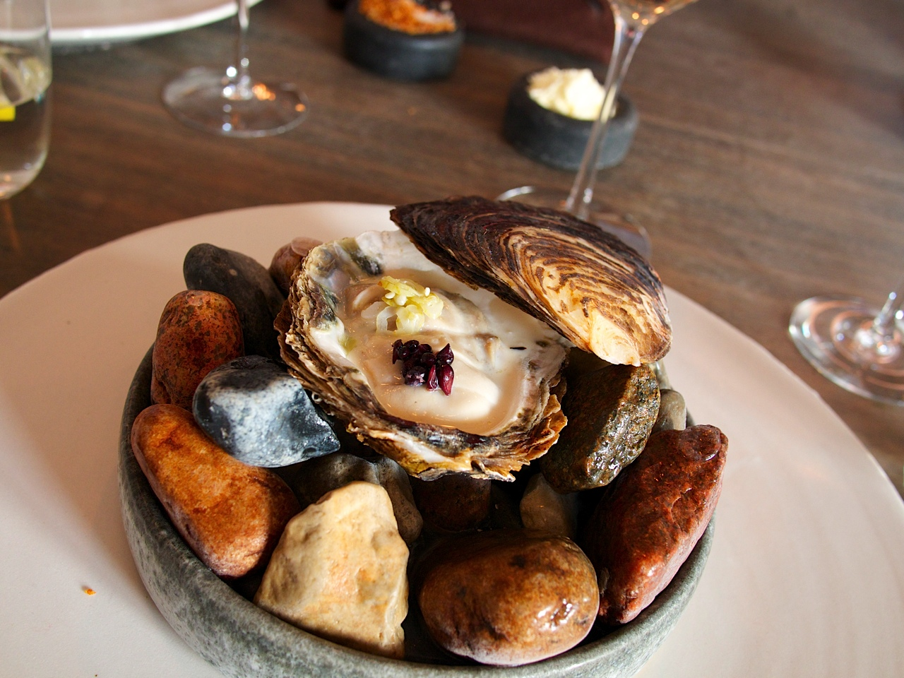 Though not on the radar of most gastronomic restaurants, Limfjorden oysters are considered among the best in the world. In North Jutland, Limfjorden remains the wild oyster bed of the endangered original European oyster. The waters they live in are practically the northern border of the European oyster's natural habitat. It's simply too cold for the oysters to spawn, and the population depletes in the coldest of winter. Poached very lightly for a few seconds with buttermilk and topped with chopped gooseberries, it creates a feeling of the ocean bed melting on the palate.