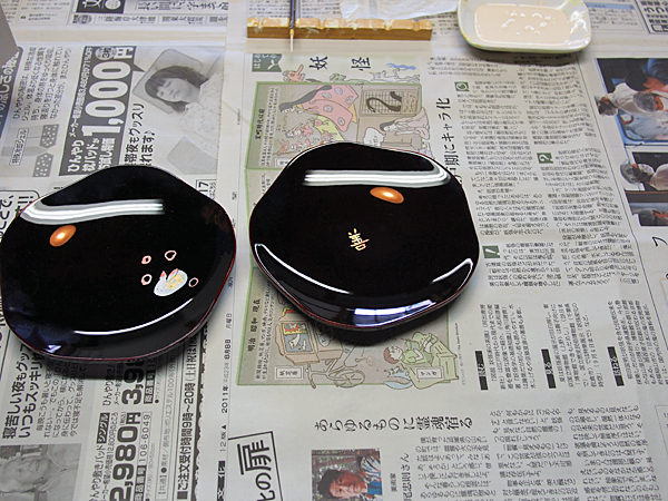 Two lacquer plates as decorated by me and my guide