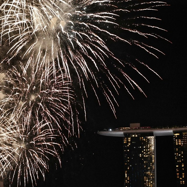 Great view from Jing restaurant of Marina Bay Sands and the fireworks that closed the Singapore National Day rehearsal. So proud of my 3 year old who watched the whole show despite being scared by the loud noises of the fireworks. #singapore #fireworks #singaporenationalday #mbs
