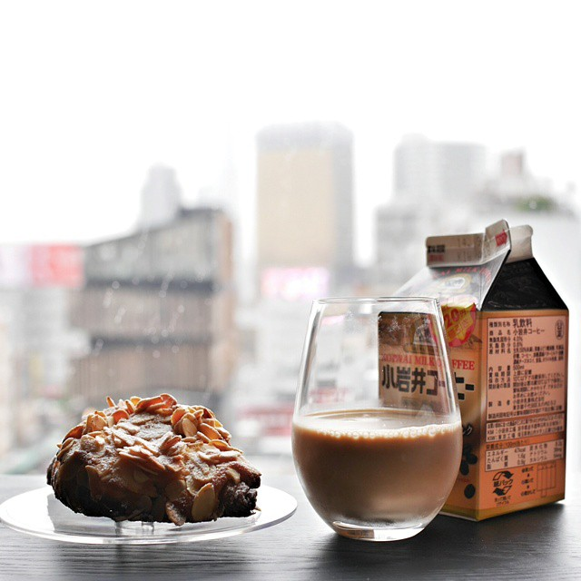 Rainy day in Tokyo. We're having brekkie in our hotel room. Picked up yummy pastries from the Robuchon and Sadaharu Aoki stalls in ShinQs department store yesterday evening. This is Robuchon's caramel sel croissant. From our window, you can usually see the Tokyo Sky Tree. Today, it's totally disappeared because of the rain and cloud cover. #goodmorning #breakfast #brekkie #foodie #foodporn #foodphotography #croissant #saltedcaramel #rainyday #stayinginforbreakfast #debachika #tokyo #japan