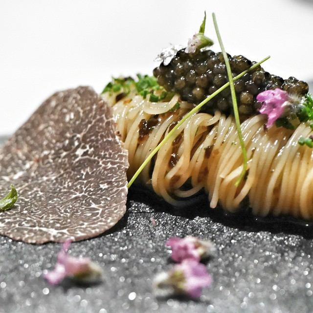 One of the best amuse bouches in town. Angel hair pasta tossed on konbu ans chopped truffles with oscietra caviar and served with shiso flowers and a big ass slice of black winter truffle. #lesamis @chef_sebastien #foodie #foodporn #foodphotography #sgeats #singapore #restaurant #singaporerestaurants #pasta #truffle  #caviar #gastroart #onthetable #theartofplating #truecooks #thefeedfeed #finedining #chefsofinstagram #amusebouche